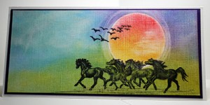 Wiid horses stamped over a beautifully blended background of Panpastel Blues & Greens